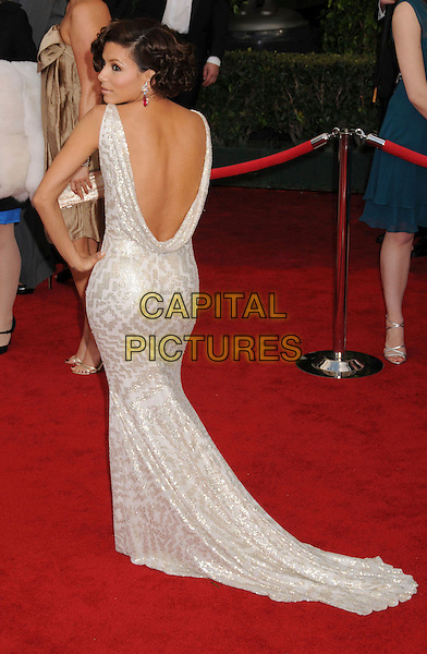 EVA LONGORIA.14th Annual Screen Actors Guild Awards held at the Shrine Auditorium, Los Angeles, California, USA..January 27th, 2008.SAG red carpet arrivals full length silver white gold patterned pattern print dress back rear behind over shoulder backless hand on hip.CAP/ADM/BP.©Byron Purvis/AdMedia/Capital Pictures. *** Local Caption *** .