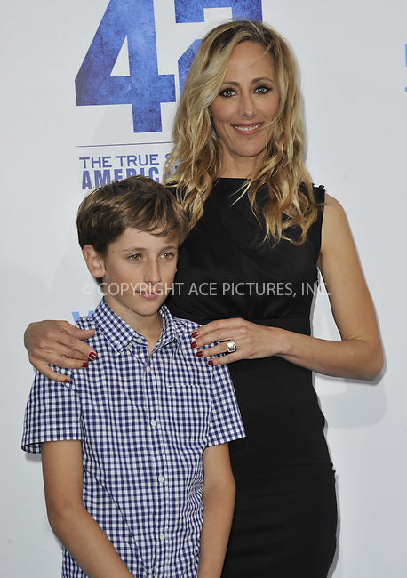 WWW.ACEPIXS.COM....April 9 2013, New York City......Kim Raver and her son arriving at the premiere of '42' at the Chinese Theatre on April 9, 2013 in Los Angeles, California. ......By Line: Peter West/ACE Pictures......ACE Pictures, Inc...tel: 646 769 0430..Email: info@acepixs.com..www.acepixs.com