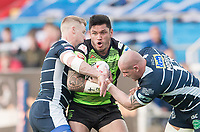 Picture by Allan McKenzie/SWpix.com - 11/05/2017 - Rugby League - Ladbrokes Challenge Cup - Featherstone Rovers v Halifax RLFC - The LD Nutrition Stadium, Featherstone, England  - Halifax's Adam Tangata is tackled by  Featherstone's IKeal Carlile & Richard Moore.