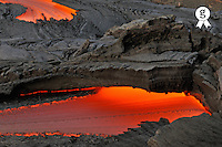 River of molten lava flowing to the sea (Licence this image exclusively with Getty: http://www.gettyimages.com/detail/83842172 )