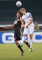 Kansas City Wizards midfielder Chance Myres (7) heads the ball against DC United defender Juan Manuel Pena (3).  DC United defeated The Kansas City Wizards  2-0 at RFK Stadium, Wednesday  May 5, 2010.