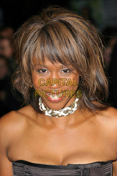 TRISHA GODDARD.National Television Awards 2003 Held At The Royal Albert Hall, South Kensington, London.28th October 2003  .Ref: Ten.headshot, portrait , choker, necklace.www.capitalpictures.com.sales@capitalpictures.com.©Capital Pictures