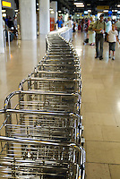 Row of trolleys parked at Madrid-Barajas Airport, Madrid, Spain.