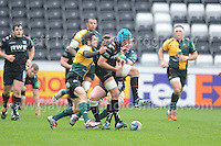 Ospreys Justin Tipuric loses possession of the ball as he gets tackled. Liberty Stadium, Swansea, South Wales 12.01.14. Ospreys v Northampton Heineken Cup round 5 pool 1 - pIc credit Jeff Thomas photography