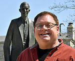Aaron Williams stands near the life-size statue of Robert Wadlow, also known as The Alton Giant. He is the force behind a visual literary art piece being created in the 2800 block of College Avenue in Alton, Illinois. Williams is founder and champion of the 7th Grade Poetry Foundation based in St. Louis.