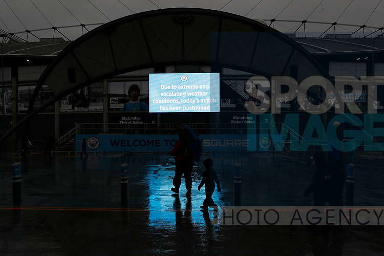 Fans leave after the Premier League match between Manchester City and West Ham United was postponed because of weather conditions at the Etihad Stadium, Manchester. Picture date: 9th February 2020. Picture credit should read: Darren Staples/Sportimage