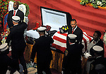 Firefighters salute late colleague during the funeral for Hartford firefighter Kevin Bell, Monday, Oct 13, 2014, at the First Cathedral, in Bloomfield, Bell was killed in a house fire last week in Hartford. (AP Photo / Journal Inquirer, Jim Michaud)