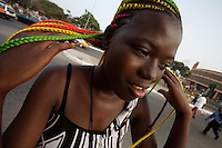 Jacqueline, 17 years old shows her colorful extensions  while awaiting for the 50th anniversary of her countries' independence  in Accra, Ghana on Monday March 05 2007..