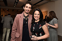 "NEW YORK CITY - APRIL 20: (L-R) Actor Robert Sheehan and Courteney Monroe, CEO, National Geographic Global Networks, attend the Sotheby's lunch and private preview of works by Picasso in conjunction with the National Geographic show ""Genius: Picasso"" at Sotheby's on April 20, 2018 in New York City. (Photo by Anthony Behar/ National Geographic/PictureGroup)"
