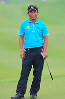 Thongchai Jaidee (THA) misses his putt on the 1st green during Thursday's Round 1 of the 2014 BMW Masters held at Lake Malaren, Shanghai, China 30th October 2014.<br /> Picture: Eoin Clarke www.golffile.ie