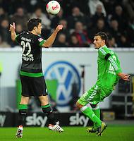 FUSSBALL   1. BUNDESLIGA    SAISON 2012/2013    13. Spieltag   VfL Wolfsburg - SV Werder Bremen                          24.11.2012 Sokratis Papastathopoulos (li, SV Werder Bremen) gegen Bas Dost (re, VfL Wolfsburg)