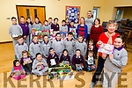 Leah Ní Dhonill and the pupils of Gaelscoil Faithleann Killarney presented Mary Healy toys they donated to St Vincent de Paul on Monday