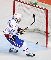 April 28, 2007; Hamilton, ON, CAN; Hamilton Bulldogs centre (17) Kyle Chipchura scores an empty net goal against the Rochester Americans during the third periof of game six in the AHL north division semifinal at Copps Coliseum. The Bulldogs won 6-2 and eliminated the Americans from the playoffs. Mandatory Credit: Ron Scheffler, Special to the Spectator. (File number RRSA8563).