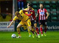 Lincoln City's Liam Bridcutt vies for possession with Milton Keynes Dons' Dean Lewington<br /> <br /> Photographer Andrew Vaughan/CameraSport<br /> <br /> The EFL Sky Bet League One - Lincoln City v Milton Keynes Dons - Tuesday 11th February 2020 - LNER Stadium - Lincoln<br /> <br /> World Copyright © 2020 CameraSport. All rights reserved. 43 Linden Ave. Countesthorpe. Leicester. England. LE8 5PG - Tel: +44 (0) 116 277 4147 - admin@camerasport.com - www.camerasport.com