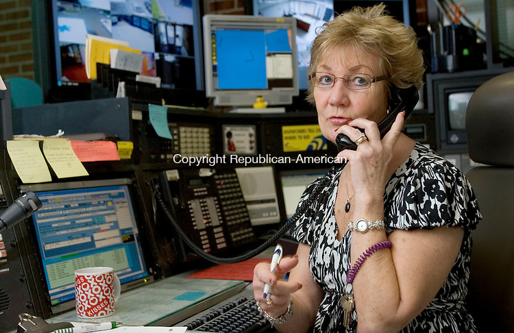 MIDDLEBURY, CT. 29 June 2011-062911SV06--Barbara Bouffard, police dispatcher, works at the station in Middlebury Wednesday. Bouffard retires this week after a 38-year career with the town. She is one of the longest serving town employees.<br /> Steven Valenti Republican-American