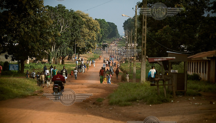 People travel down the main road in the town of Bossangoa.