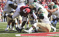 NWA Media/Michael Woods --10/25/2014-- w @NWAMICHAELW...University of Arkansas running back Alex Collins pushes his way through the Alabama Birmingham defense to score a touchdown in the 1st quarter of Saturday's game at Razorback Stadium in Fayetteville.