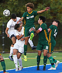 WATERBURY  CT. - 14 October 2019-101419SV10- From left, #4 Nelson Lavoura and #1 Saul Pujols of Naugatuck High go up for the ball with #11 Kadin Talha, #18 Luke Zipoli and #14 Thomas Pompei of Holy Cross High during NVL Soccer action in Waterbury Monday.<br />Steven Valenti Republican-American