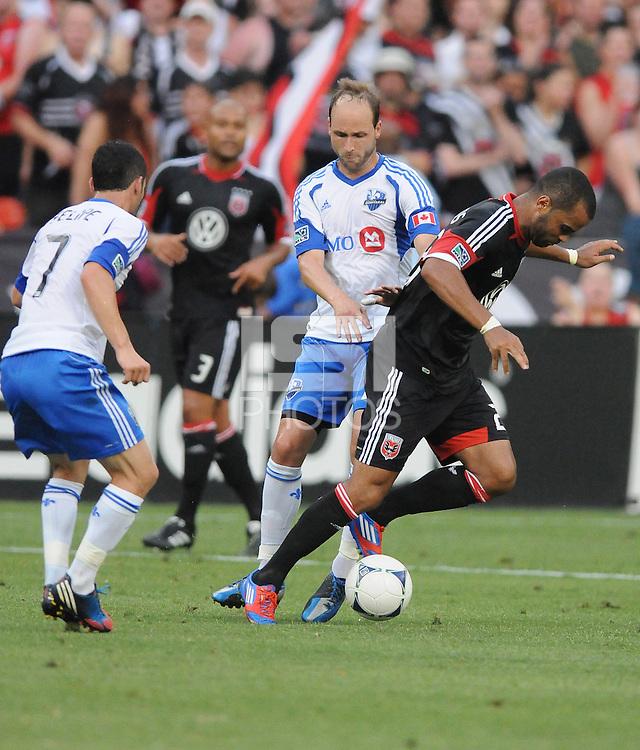 D.C. United forward Maicon Santos (29) goes against Montreal Impact midfielder Justin Mapp (21) D.C. United defeated Montreal Impact 3-0 at RFK Stadium, Saturday June 30, 2012.