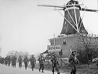 Infantry of the Regiment de Maisonneuve moving through Holten to Rijssen, both towns in the Netherlands.  9 April 1945.  Lt. D. Guravitch.  Canadian Military photograph.  New York Times Paris Bureau Collection.  (USIA)<br /> NARA FILE #:  306-NT-1334B-11<br /> WAR &amp; CONFLICT BOOK #:  1081