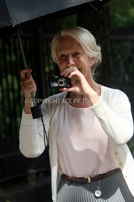 WWW.ACEPIXS.COM . . . . .  ....July 12 2010, New York City....Actess Helen Mirren on the East Village set of the new movie 'Arthur' on July 12 2010 in New York City....Please byline: NANCY RIVERA- ACEPIXS.COM.... *** ***..Ace Pictures, Inc:  ..Tel: 646 769 0430..e-mail: info@acepixs.com..web: http://www.acepixs.com