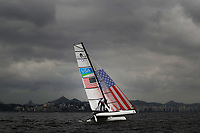 RIO DE JANEIRO, BRAZIL - AUGUST 10:  Bora Gulari of the United States and Louisa Chafee of the United States compete in the Nacra 17 Mixed class on Day 5 of the Rio 2016 Olympic Games at the Marina da Gloria on August 10, 2016 in Rio de Janeiro, Brazil.  (Photo by Ezra Shaw/Getty Images)