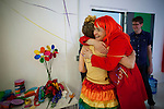 BROOKLYN -- APRIL 16, 2011: Jessi Arrington (L) hugs Tina Roth Eisenberg (R) at Studiomates during their rainbow parade/garage sale / birthday party on April 16, 2011 in Dumbo, Brooklyn.   (PHOTOGRAPH BY MICHAEL NAGLE)
