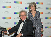 Itzhak Perlman and wife Toby arrive for the formal Artist's Dinner honoring the recipients of the 38th Annual Kennedy Center Honors hosted by United States Secretary of State John F. Kerry at the U.S. Department of State in Washington, D.C. on Saturday, December 5, 2015. The 2015 honorees are: singer-songwriter Carole King, filmmaker George Lucas, actress and singer Rita Moreno, conductor Seiji Ozawa, and actress and Broadway star Cicely Tyson.<br /> Credit: Ron Sachs / Pool via CNP