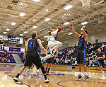 SIOUX FALLS, SD - DECEMBER 5:  Charles Ward #22 from the University of Sioux Falls drives the lane against Upper Iowa in the second half of their game Friday night at the Stewart Center.  (Photo by Dave Eggen/inertia)