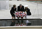 New York, NY - September 10, 2006 -- United States President George W. Bush and first lady Laura Bush attended a solem ceremony at the base of Ground Zero to mark the five year anniversary of the terrorist attacks.. The president and first lady laid a wreath in a small ceremonial pool.  Also on hand was New York City Mayor Michael Bloomberg, New York Governor George Pataki, and former NYC mayor Rudy Giuliani.<br /> Credit: Gary Fabiano - Pool via CNP