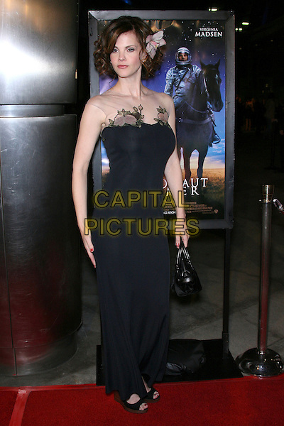 "KIERSTEN WARREN.""The Astronaut Farmer"" World Premiere - Arrivals held at the Cinerama Dome, Hollywood, California , USA, .20 February 2007..full length black dress flower in hair clip accessory.CAP/ADM/ZL.©Zach Lipp/AdMedia/Capital Pictures."