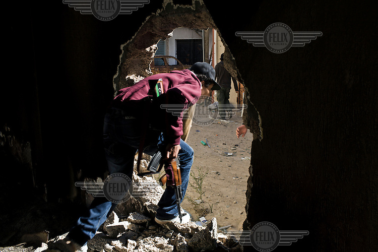 Ahmed, a rebel fighter moves from house to house in the back streets of Misurata to take up positions to fire on Gaddafi forces. On 17 February 2011 Libya saw the beginnings of a revolution against the 41 year regime of Col Muammar Gaddafi.