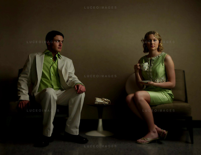 """Ryan Mills wears a 1MX dress shirt, $49, Seersucker pin-striped suit jacket, $178, and Seersucker pin-striped suit pants, $78, from Express for Men. Ashley Litviak wears a Kay Unger silk beaded dress, $408, from The Wardrobe. kpgec """"Green Envy"""""""
