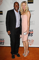 CENTURY CITY, CA, USA - MAY 02: Byron Allen, Jennifer Lucas at the 21st Annual Race To Erase MS Gala held at the Hyatt Regency Century Plaza on May 2, 2014 in Century City, California, United States. (Photo by Celebrity Monitor)