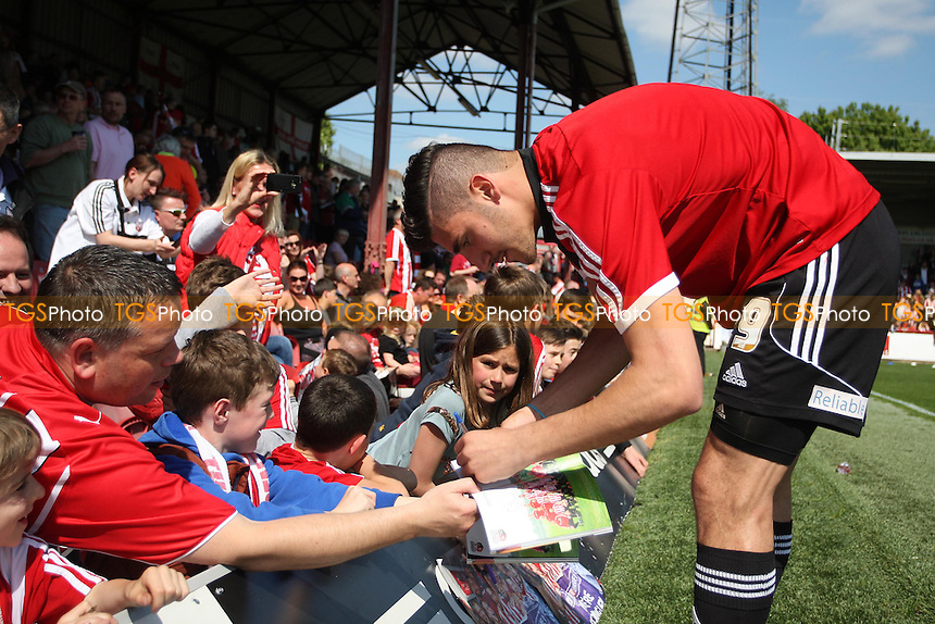 Marcello Trotta of Brentford signs autographs before kick off- Brentford vs Stevenage - Sky Bet League One Football at Griffin Park, Brentford, London - 03/05/14 - MANDATORY CREDIT: George Phillipou/TGSPHOTO - Self billing applies where appropriate - 0845 094 6026 - contact@tgsphoto.co.uk - NO UNPAID USE