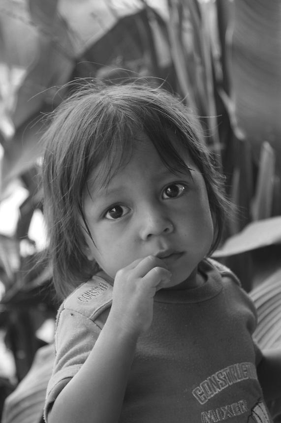 Quechua child in jungle village on the Rio Napo downstream from Chantapunta, Ecuador