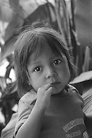 Quechua child in jungle village on the Rio Napo downstream from Chantapunta, Ecuador
