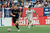 FOXBOROUGH, MA - AUGUST 3: Walker Zimmerman #25 of Los Angeles FC brings the ball forward as Gustavo Bao #7 of New England Revolution closes during a game between Los Angeles FC and New England Revolution at Gillette Stadium on August 3, 2019 in Foxborough, Massachusetts.