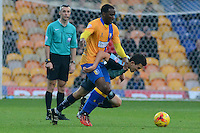 Wycombe Wanderers Luke O'Nien is under pressure from Mansfield Town's Craig Westcarr during the Sky Bet League 2 match between Mansfield Town and Wycombe Wanderers at the One Call Stadium, Mansfield, England on 31 October 2015. Photo by Garry Griffiths.
