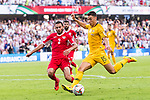 Chris Ikonomidis of Australia (R) fights for the ball with Feras Zeyad Shilbaya of Jordan during the AFC Asian Cup UAE 2019 Group B match between Australia (AUS) and Jordan (JOR) at Hazza Bin Zayed Stadium on 06 January 2019 in Al Ain, United Arab Emirates. Photo by Marcio Rodrigo Machado / Power Sport Images