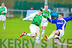 Kerry's Adam O'Rourke and Desmond League's Cormac Roche challenge for the ball at Mouthawk park, Tralee on Saturday.