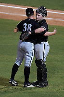 Closer Matthew Foster (38) of the Kannapolis Intimidators, left, embraces catcher Evan Skoug (14) after recording the final out in Game 3 of the South Atlantic League Championship series against the Greenville Drive on Thursday, September 14, 2017, at Fluor Field at the West End in Greenville, South Carolina. Kannapolis won, 5-4. Greenville leads the series 2-1. (Tom Priddy/Four Seam Images)