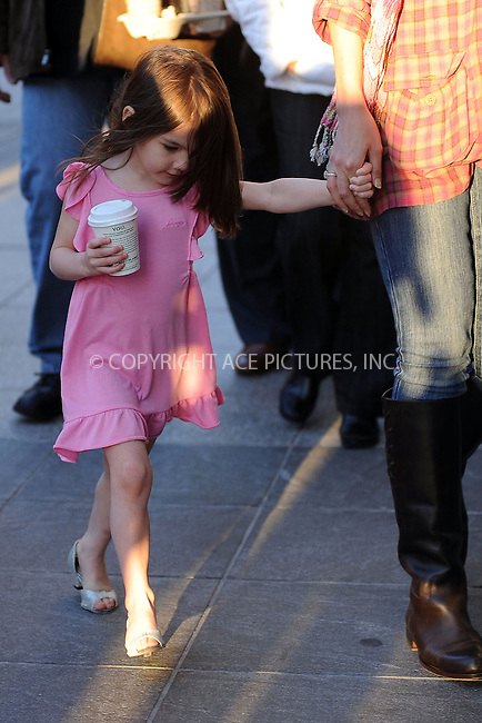 WWW.ACEPIXS.COM . . . . . ....October 11 2009, Boston....Suri Cruise walks back to her hotel in Boston with her mother Katie Holmes. Tom Cruise is in Boston shoot a movie. October 11 2009, Boston, MA....Please byline: KRISTIN CALLAHAN - ACEPIXS.COM.. . . . . . ..Ace Pictures, Inc:  ..(212) 243-8787 or (646) 679 0430..e-mail: picturedesk@acepixs.com..web: http://www.acepixs.com