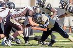 Palos Verdes, CA 11/01/13 - Julius Lagmay (Peninsula #37) and Benton Shortridge (West Torrance #52) in action during the West Torrance vs Palos Verdes Peninsula Varsity football game at Palos Verdes Peninsula High School.
