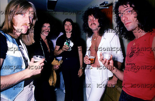 JOURNEY - L-R: Ross Valory, Neal Schon, Steve Perry, Gregg Rollie, Aynsley Dunbar - having drinks in the offices of CBS Records in Los Angeles CA USA - 1978.  Photo <br />