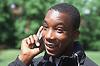 Teenage boy standing outdoors talking on mobile phone,