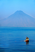 Fisherman plying the waters of Lake Atitlan, Western Highlands, Guatemala
