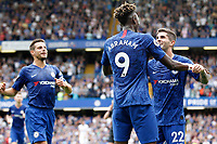 GOAL - Tammy Abraham of Chelsea is congratulated after scoring during the Premier League match between Chelsea and Sheff United at Stamford Bridge, London, England on 31 August 2019. Photo by Carlton Myrie / PRiME Media Images.