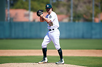 Oakland Athletics pitcher Wyatt Marks (56) prepares to deliver a pitch to the plate during an Instructional League game against the Cincinnati Reds on September 29, 2017 at Lew Wolff Training Complex in Mesa, Arizona. (Zachary Lucy/Four Seam Images)