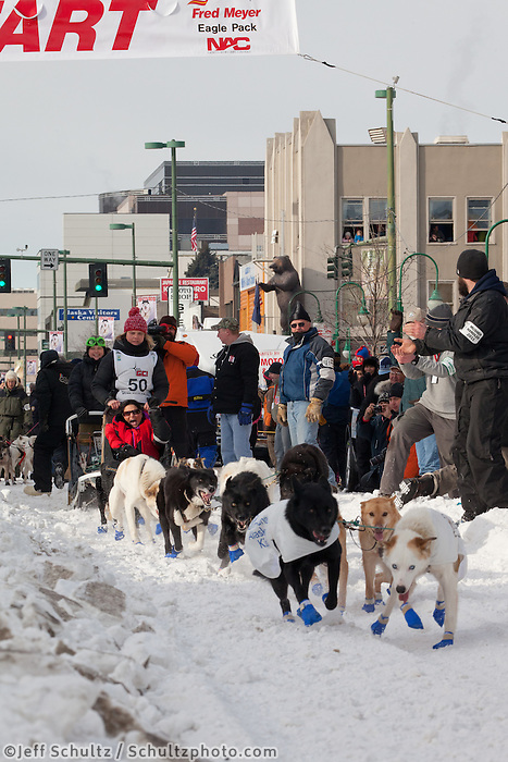 Musher Heather Siirtola and Iditarider Kathy Nicholson.leave the 2011 Iditarod ceremonial start line in downtown Anchorage, Alaska